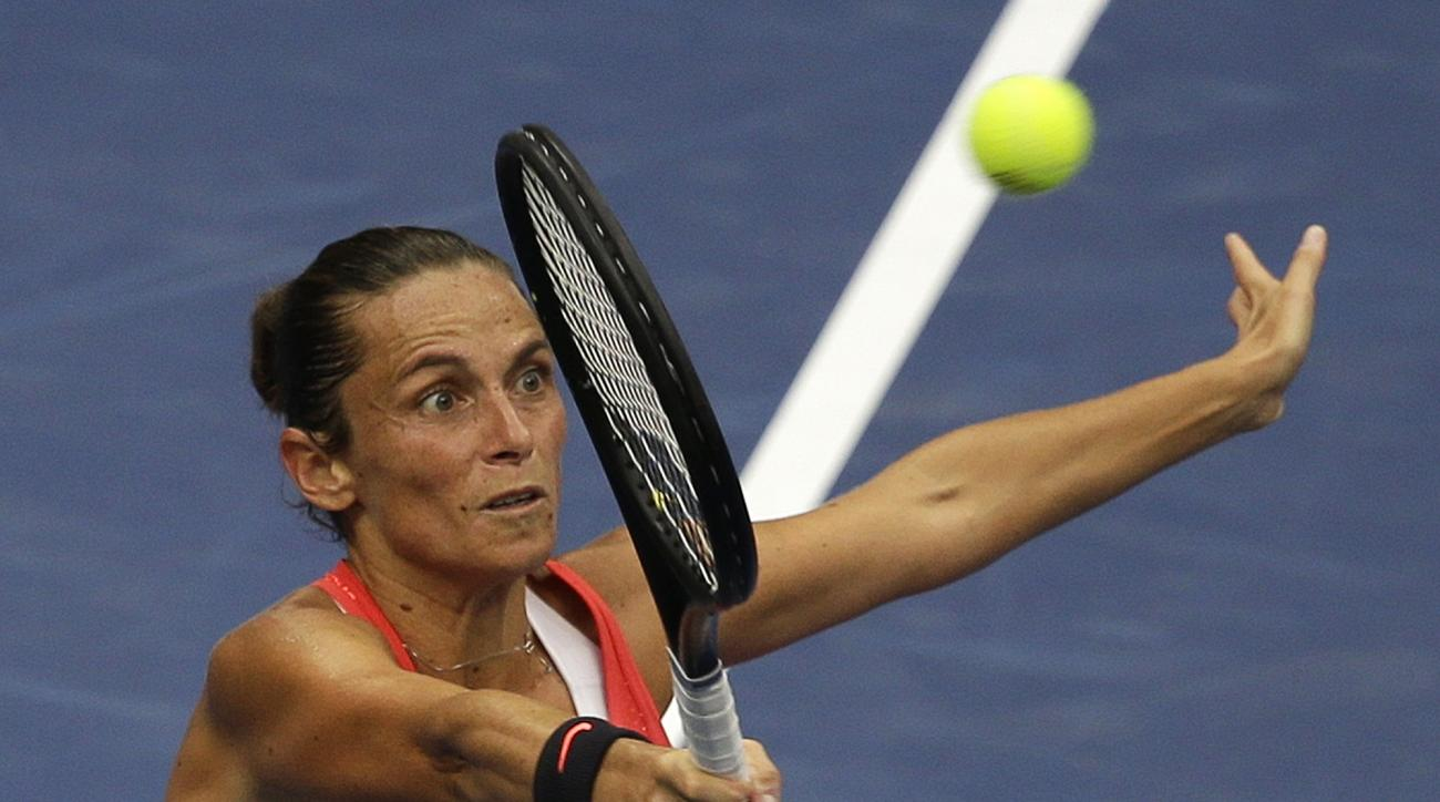Roberta Vinci, of Italy, returns a shot to Flavia Pennetta, of Italy, during the women's championship match of the U.S. Open tennis tournament, Saturday, Sept. 12, 2015, in New York. (AP Photo/Seth Wenig)