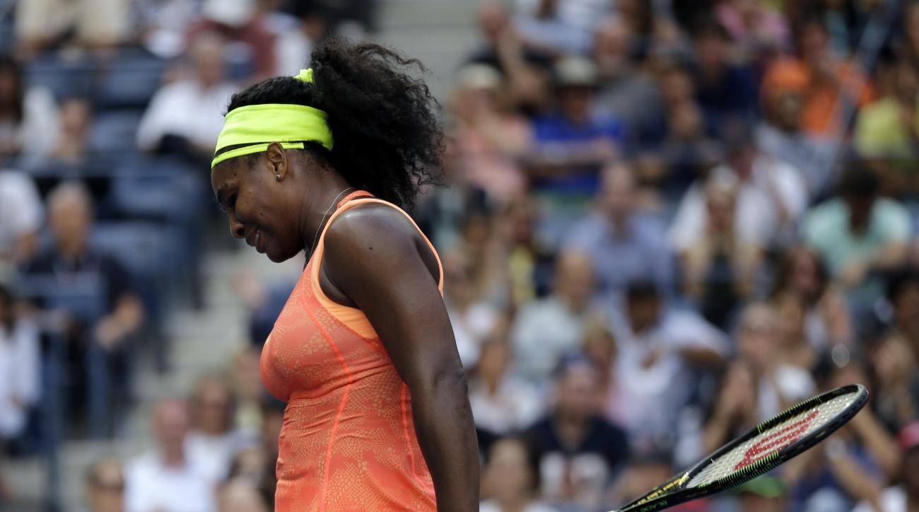 Serena Williams reacts after losing a point to Roberta Vinci, of Italy, during a semifinal match at the U.S. Open tennis tournament, Friday, Sept. 11, 2015, in New York. (AP Photo/David Goldman)