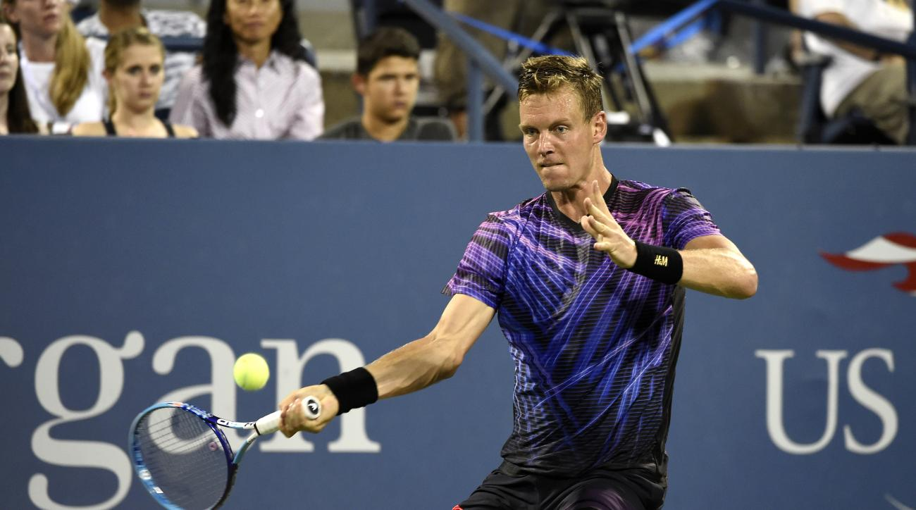 Tomas Berdych, of the Czech Republic, lines up a forehand return against Richard Gasquet, of France in the fourth round at the U.S. Open tennis tournament on Monday, Sept. 7, 2015, in New York. (AP Photo/Kathy Kmonicek)