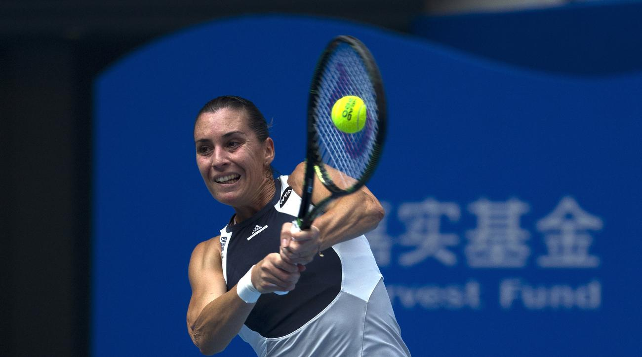 Flavia Pennetta of Italy returns a ball against Han Xinyun of China during the match of the China Open tennis tournament at the National Tennis Stadium in Beijing, Sunday, Oct. 4, 2015 (AP Photo/Andy Wong)