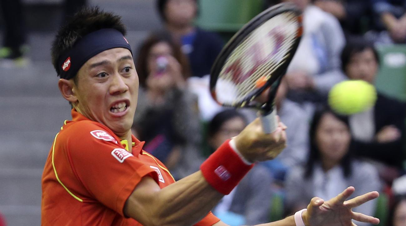 Kei Nishikori of Japan returns a shot to Borna Coric of Croatia during their first round match of the Japan Open tennis tournament in Tokyo, Monday, Oct. 5, 2015. (AP Photo/Shizuo Kambayashi)