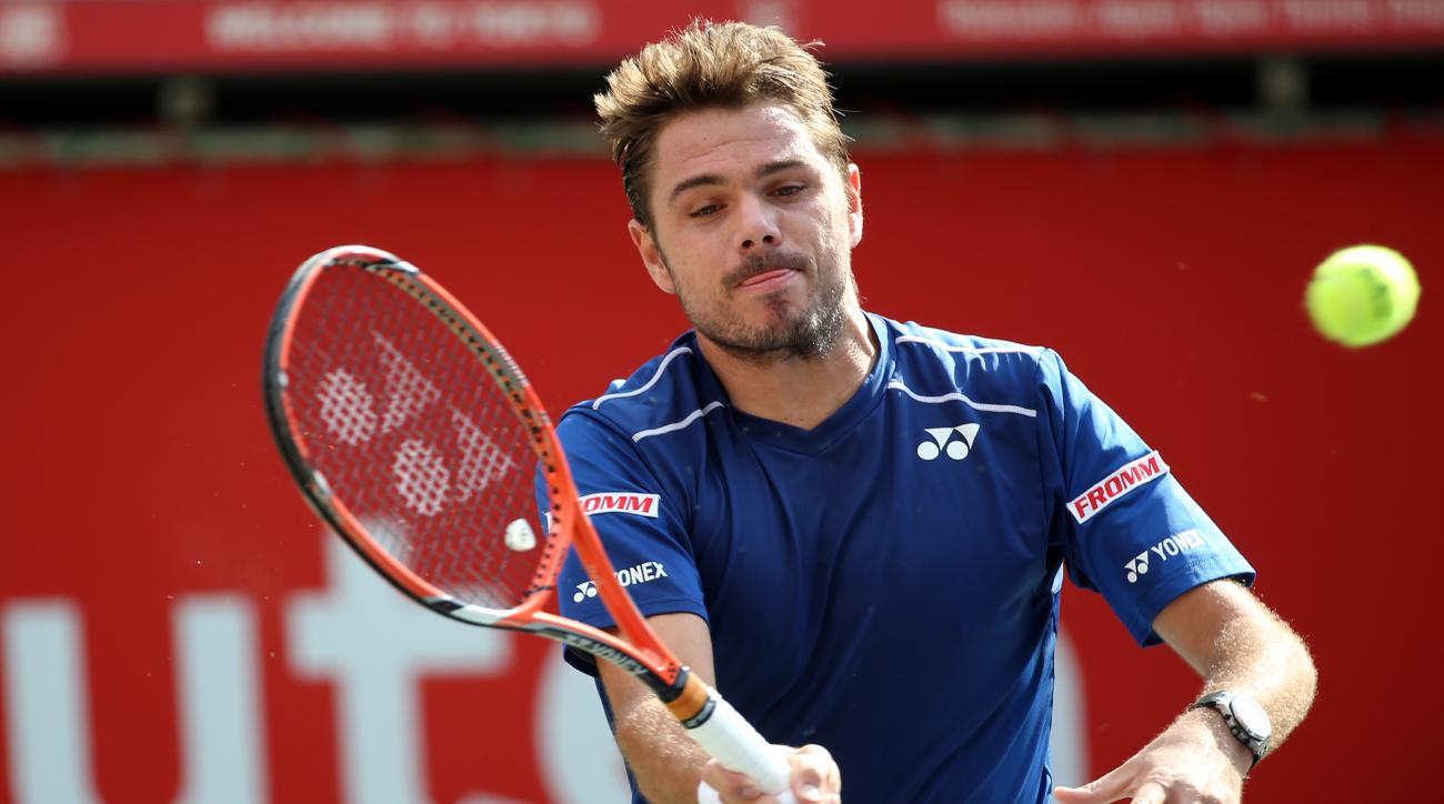 Stan Wawrinka of Switzerland returns a shot against Czech Republic's Radek Stepanek in their men's singles first round match at the Japan Open men's tennis tournament in Tokyo, Tuesday, Oct. 6, 2015. (AP Photo/Eugene Hoshiko)