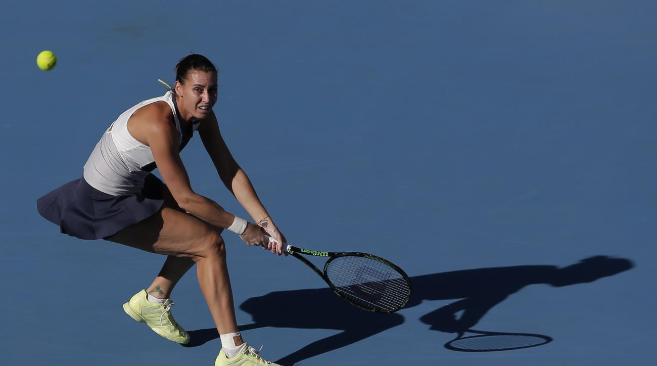 Flavia Pennetta of Italy watches the ball as she plays against Anastasia Pavlyuchenkova of Russia during their women's singles match of the China Open tennis tournament at the National Tennis Stadium in Beijing, Thursday, Oct. 8, 2015. (AP Photo/Andy Wong
