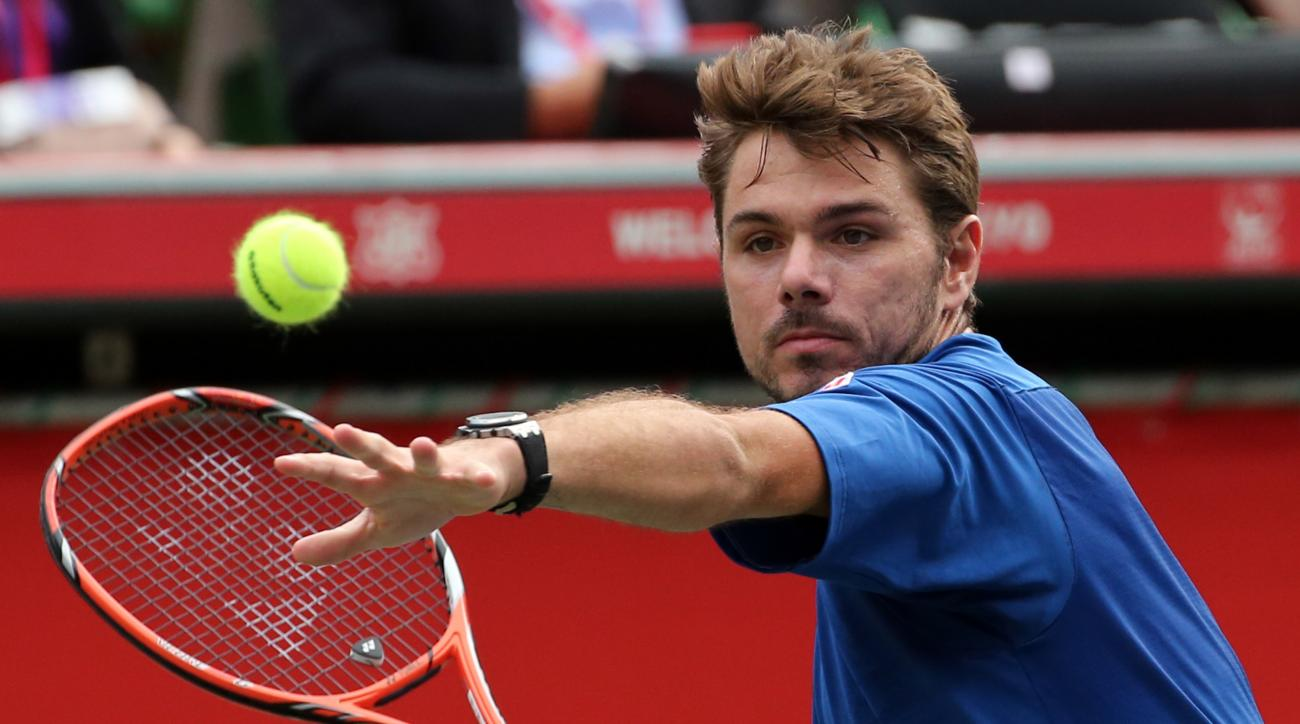 Stan Wawrinka of Switzerland returns a shot against  Austin Krajicek, of the United States, during their singles quarterfinal match at the Japan Open men's tennis tournament in Tokyo, Friday, Oct. 9, 2015. (AP Photo/Eugene Hoshiko)