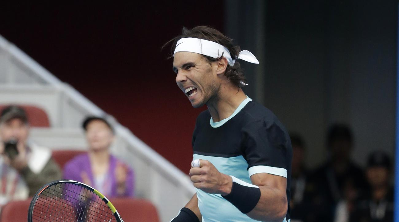 Rafael Nadal of Spain reacts after defeating Jack Sock of the United States in men's singles quarterfinal match of the China Open tennis tournament at the National Tennis Stadium in Beijing, Friday, Oct. 9, 2015. (AP Photo/Andy Wong)