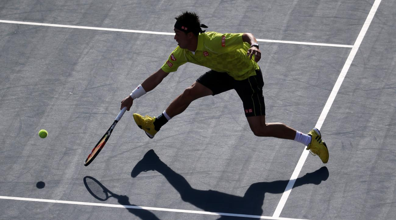 Kei Nishikori of Japan returns a shot against Marin Cilic, of Croatia during their singles quarterfinal match at the Japan Open men's tennis tournament in Tokyo, Friday, Oct. 9, 2015. (AP Photo/Eugene Hoshiko)