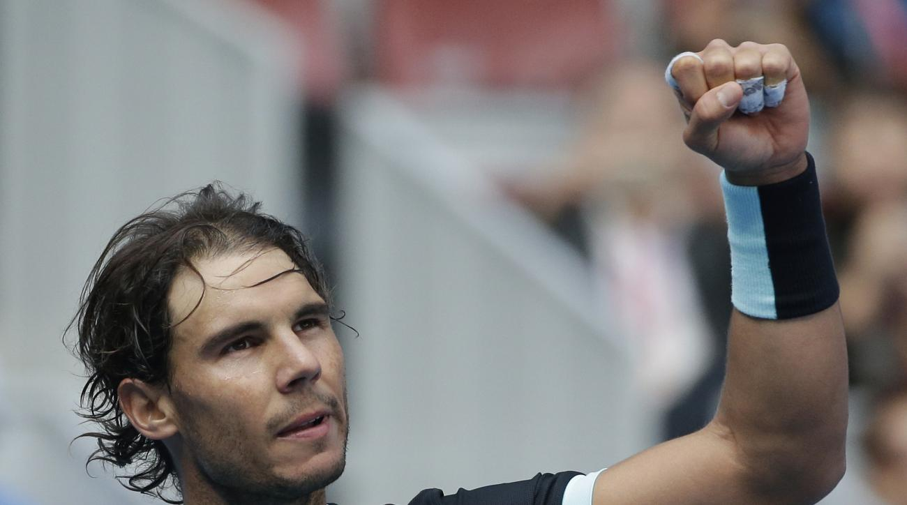 Rafael Nadal of Spain celebrates after defeating Fabio Fognini of Italy in the men's singles semifinals match of the China Open tennis tournament at the National Tennis Stadium in Beijing, Saturday, Oct. 10, 2015. (AP Photo/Andy Wong)