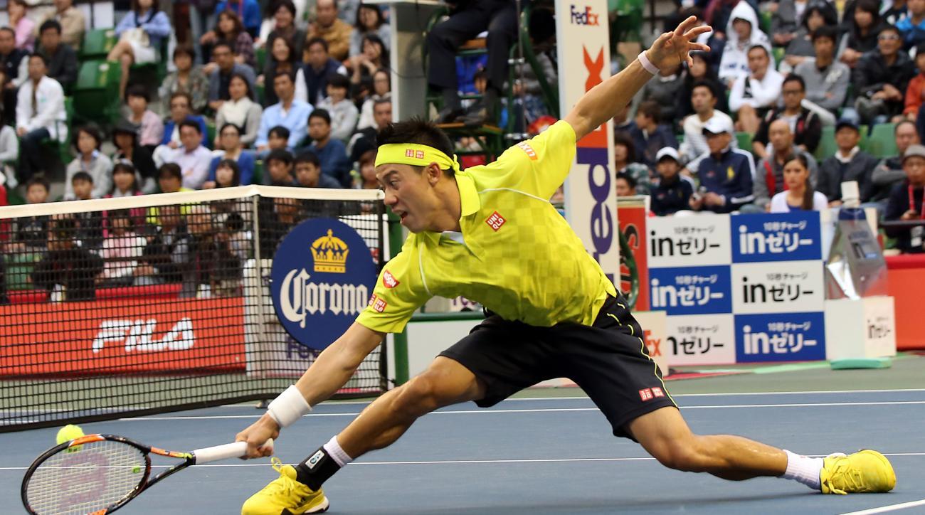 Kei Nishikori of Japan returns a shot against Benoit Paire of France during their singles semifinal match at the Japan Open men's tennis tournament in Tokyo, Saturday, Oct. 10, 2015. (AP Photo/Eugene Hoshiko)