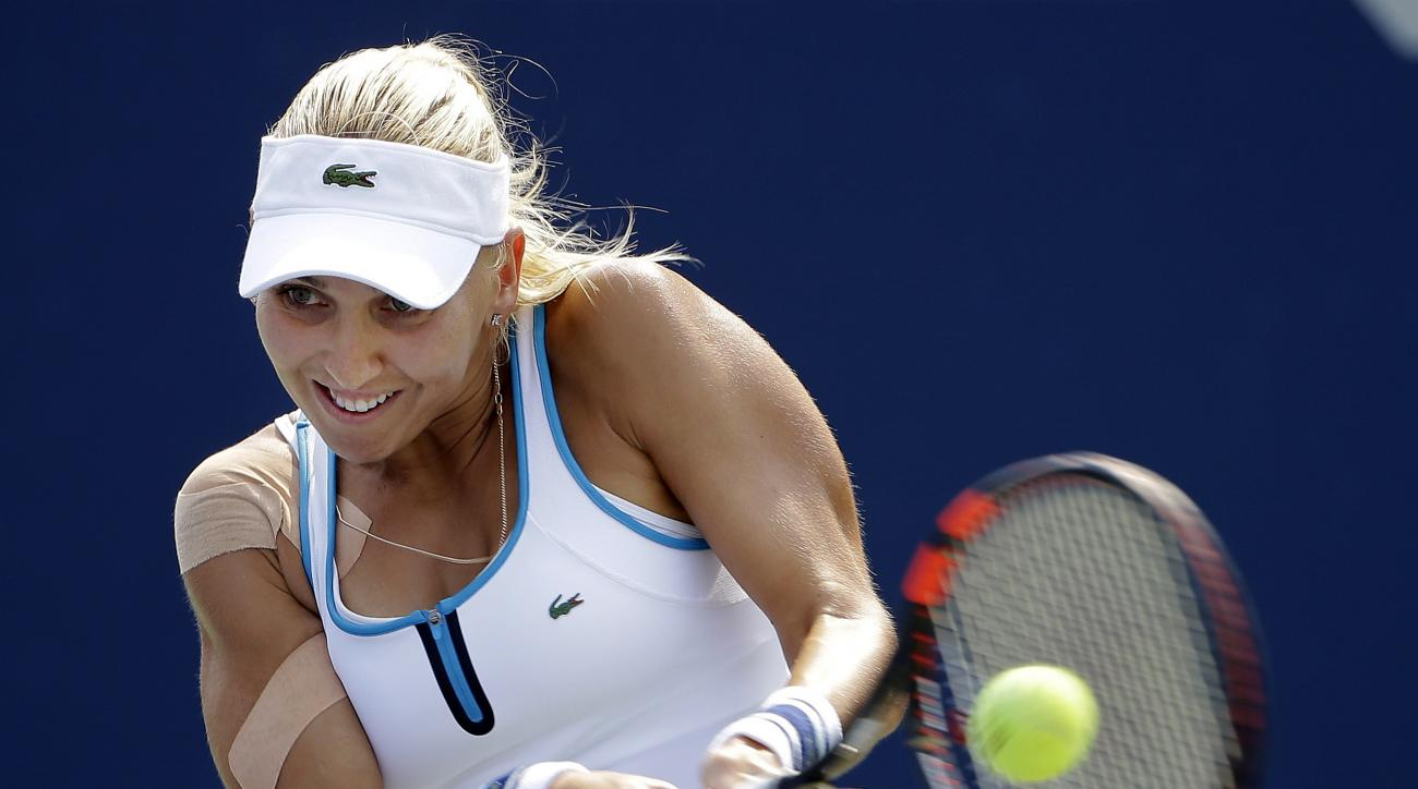 Elena Vesnina, of Russia, returns a shot to Andrea Petkovic, of Germany, during the second round of the U.S. Open tennis tournament, Thursday, Sept. 3, 2015, in New York. (AP Photo/Matt Rourke)
