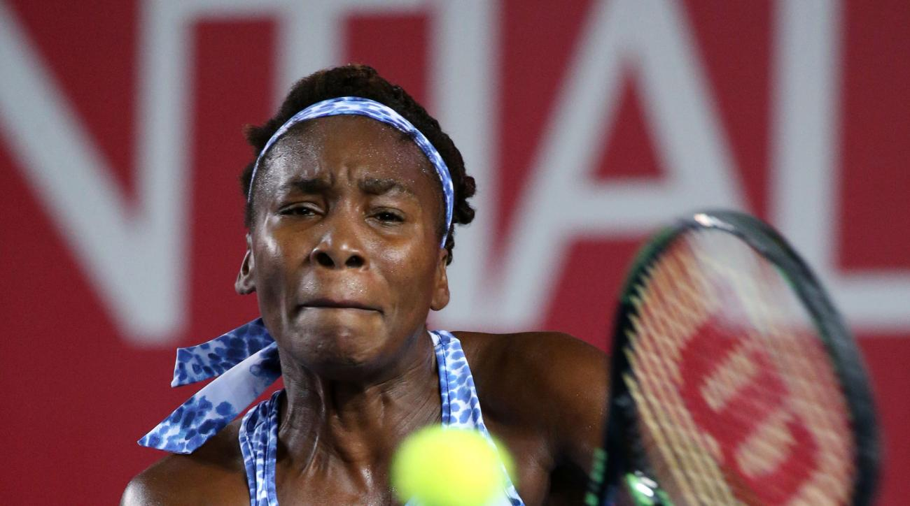 Venus Williams of the United States hits a return shot against Yuliya Beygelzimer of Ukraine at the WTA Hong Kong Open Tennis tournament in Hong Kong, Tuesday, Oct. 13, 2015. (AP Photo/Kin Cheung)