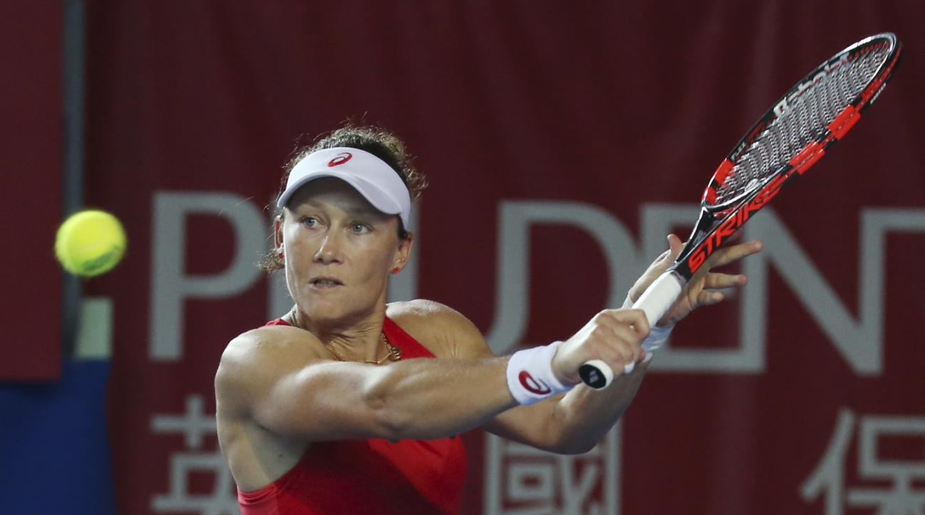 Samantha Stosur of Australia returns a shot against Monica Puig of Puerto Rica during the second round match at the WTA Hong Kong Open tennis tournament in Hong Kong, Wednesday, Oct. 14, 2015. (AP Photo/Kin Cheung)