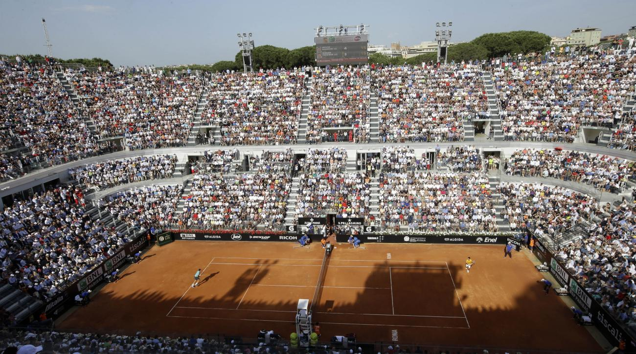 FILE - In this  Sunday, May 17, 2015 file photo, Serbia's Novak Djokovic, right, plays Switzerland's Roger Federer during their final match at the Italian Open tennis tournament, in Rome. The chief organizer of the Italian Open has threatened to move the