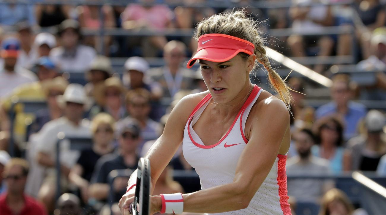 FILE- In this Sept. 4, 2015 file photo, Eugenie Bouchard, of Canada, returns a shot to Dominika Cibulkova, of Slovakia, during the third round of the U.S. Open tennis tournament in New York. Bouchard has filed a lawsuit against the United States Tennis As