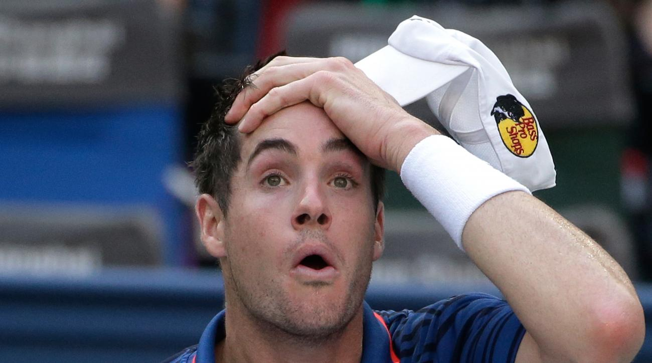 John Isner of the United States reacts as he plays against Andy Murray of Britain during their Shanghai Masters tennis tournament in Shanghai, China, Thursday, Oct. 15, 2015. (AP Photo/Andy Wong)