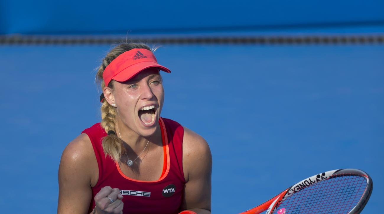 Angelique Kerber of Germany celebrates after winning her semifinal match against Samantha Stosur of Australia at the WTA Hong Kong Open tennis tournament in Hong Kong, Saturday, Oct. 17, 2015. (AP Photo/Kin Cheung)