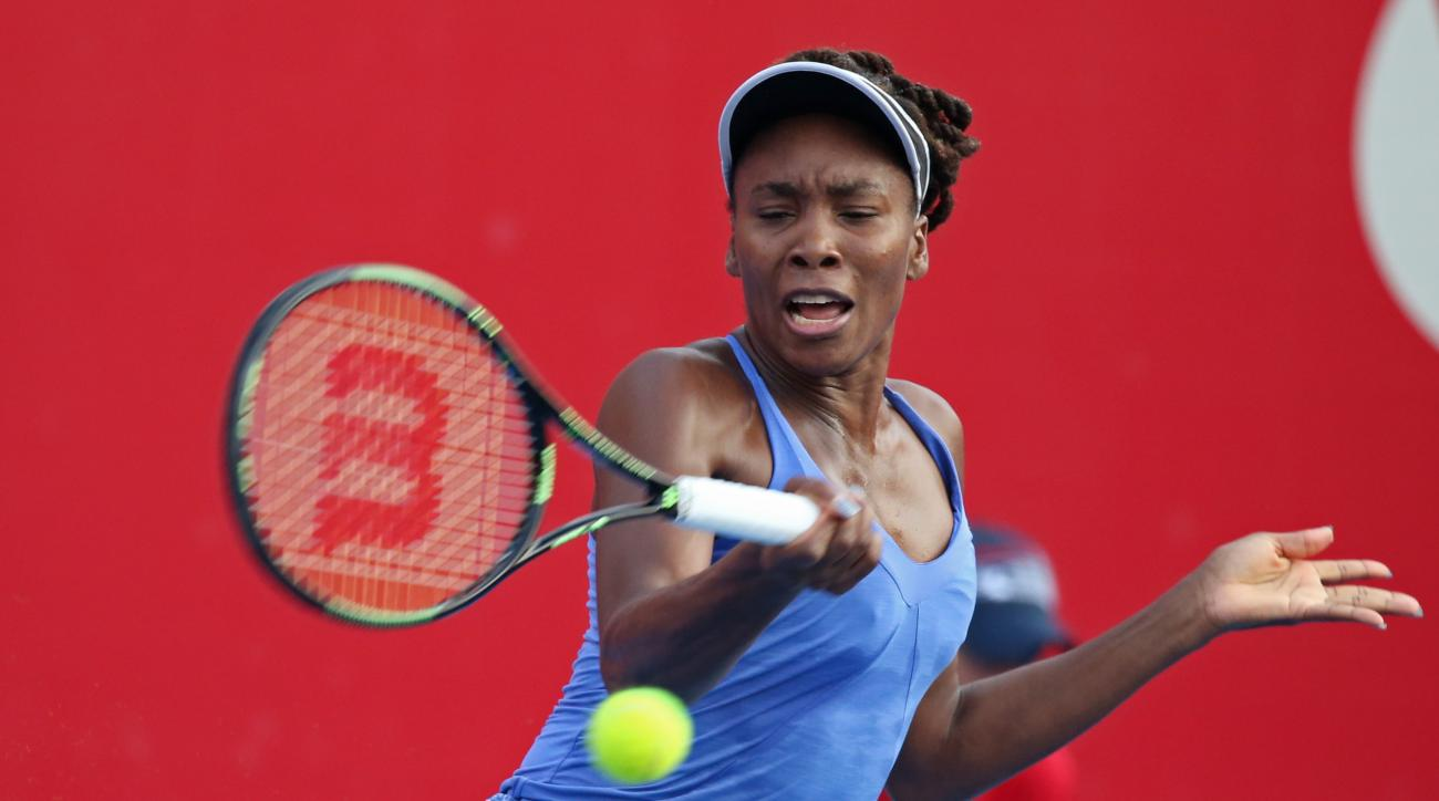 Venus Williams of the United States hits a return shot against Jelena Jankovic of Serbia during their semifinal match at the WTA Hong Kong Open tennis tournament in Hong Kong, Saturday, Oct. 17, 2015. (AP Photo/Kin Cheung)