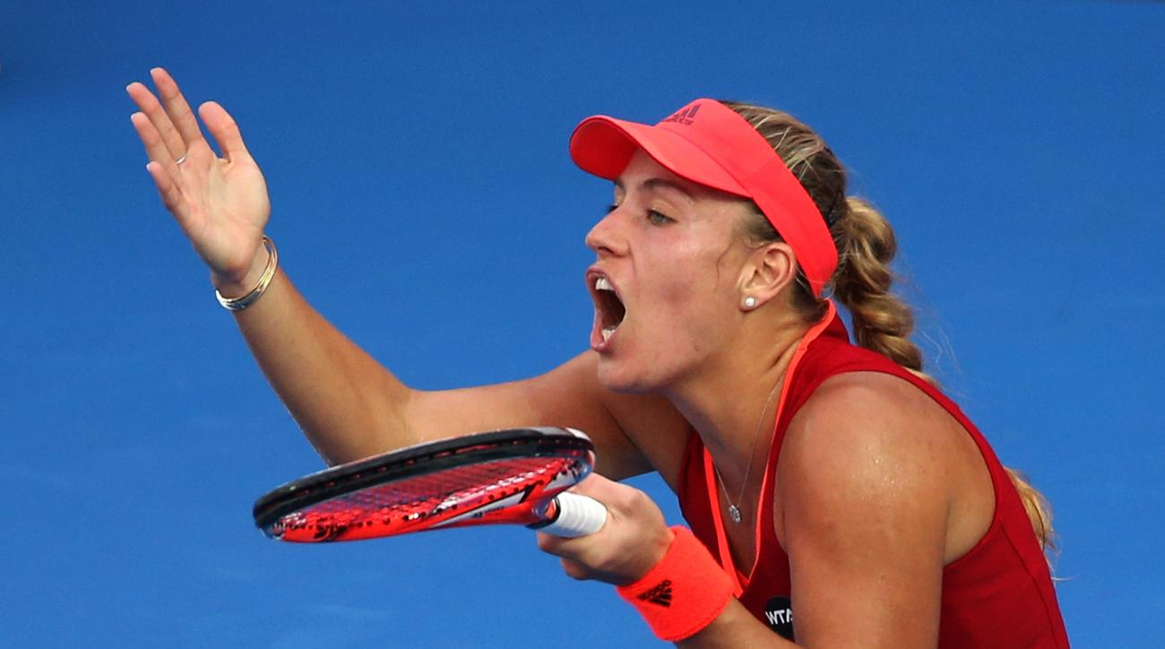 Angelique Kerber of Germany reacts  during their final match against Jelena Jankovic of Serbia at the WTA Hong Kong Open tennis tournament in Hong Kong, Sunday, Oct. 18, 2015. (AP Photo/Vincent Yu)