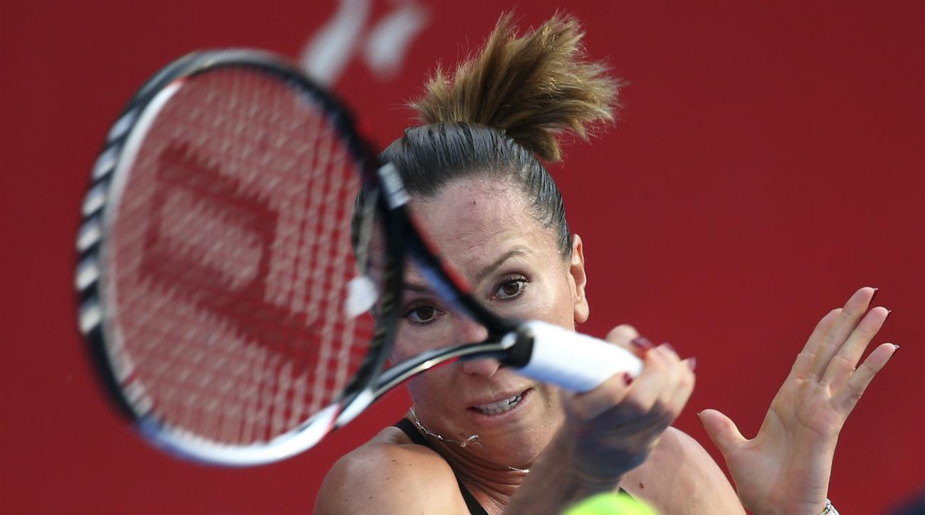 Jelena Jankovic of Serbia returns the ball against Angelique Kerber of Germany during their final match at the WTA Hong Kong Open tennis tournament in Hong Kong, Sunday, Oct. 18, 2015. (AP Photo/Vincent Yu)