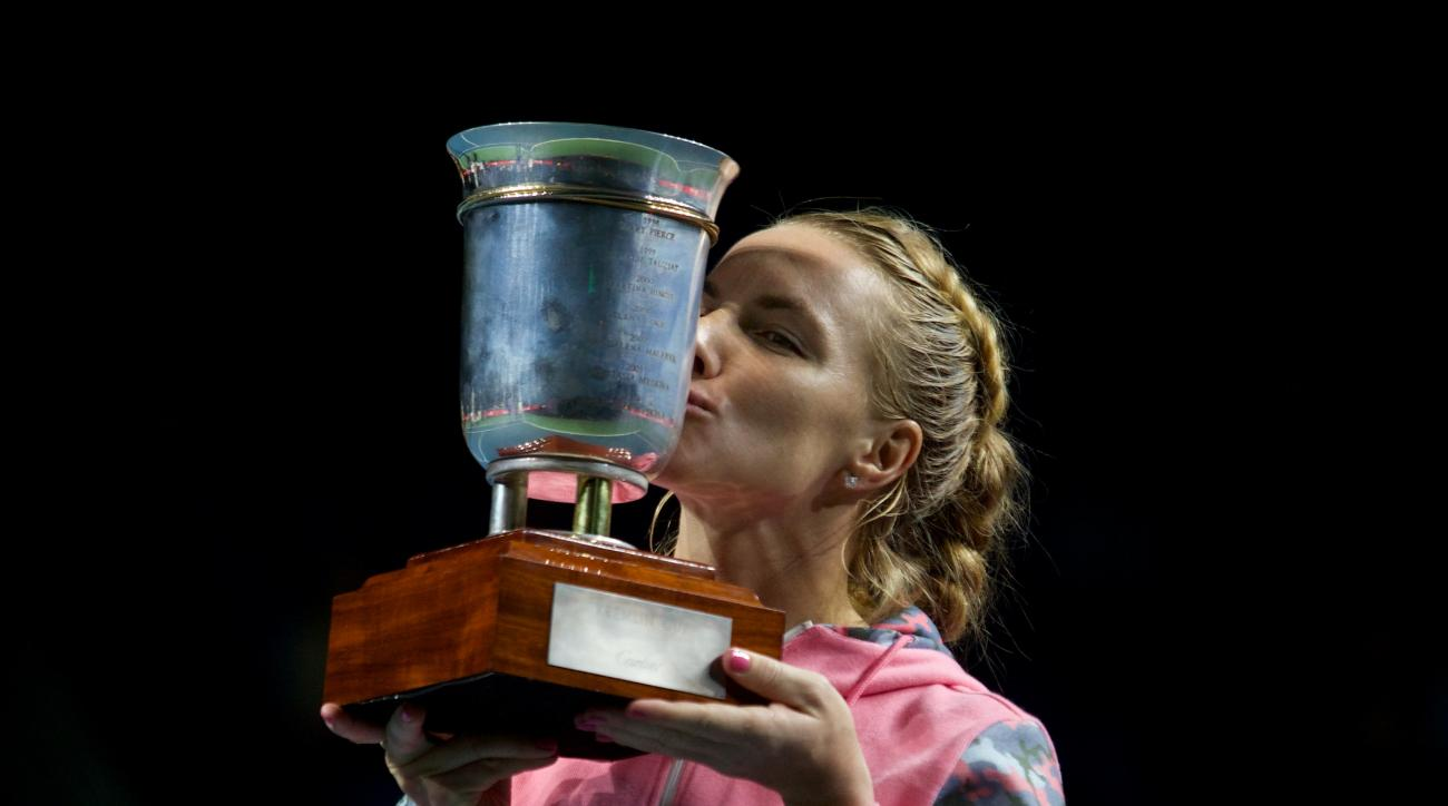 Russia's Svetlana Kuznetsova kisses her trophy after winning the Kremlin Cup tennis tournament in Moscow, Russia, Saturday, Oct. 24, 2015. (AP Photo/Ivan Sekretarev)