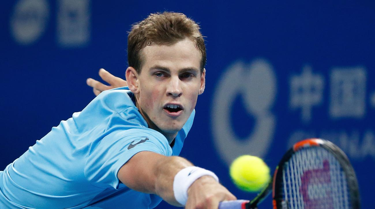 Vasek Pospisil of Canada reaches for the ball as he plays against Rafael Nadal of Spain during their second round men's singles match of the China Open tennis tournament at the National Tennis Stadium in Beijing, Wednesday, Oct. 7, 2015. (AP Photo/Andy Wo