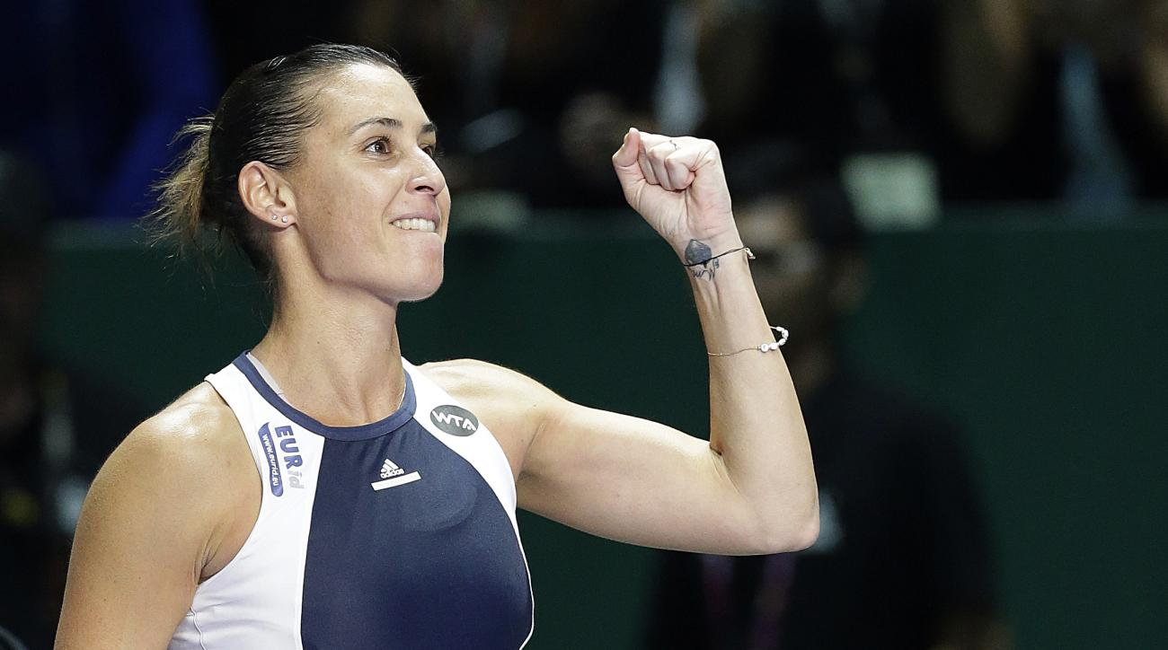 Flavia Pennetta of Italy celebrates after defeating Agnieszka Radwanska of Poland during their singles match at the WTA tennis finals in Singapore on Tuesday, Oct. 27, 2015. (AP Photo/Wong Maye-E)