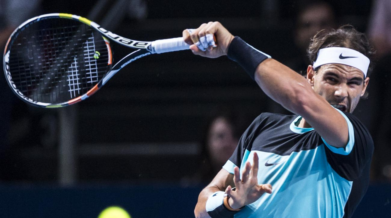 Spain's Rafael Nadal returns a ball to France's Richard Gasquet during their semifinal match at the Swiss Indoors tennis tournament at the St. Jakobshalle in Basel, Switzerland, Saturday, Oct. 31, 2015. (Dominic Steinmann/Keystone via AP)