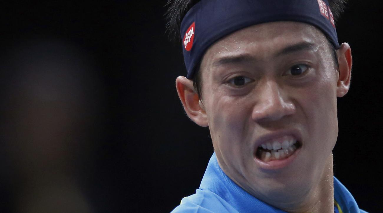 Japan's Kei Nishikori returns the ball to France's Jeremy Chardy, during their second round match of the BNP Masters tennis indoor tournament, at the refurbished Bercy Arena, in Paris, France, Wednesday, Nov. 4, 2015. (AP Photo/Francois Mori)