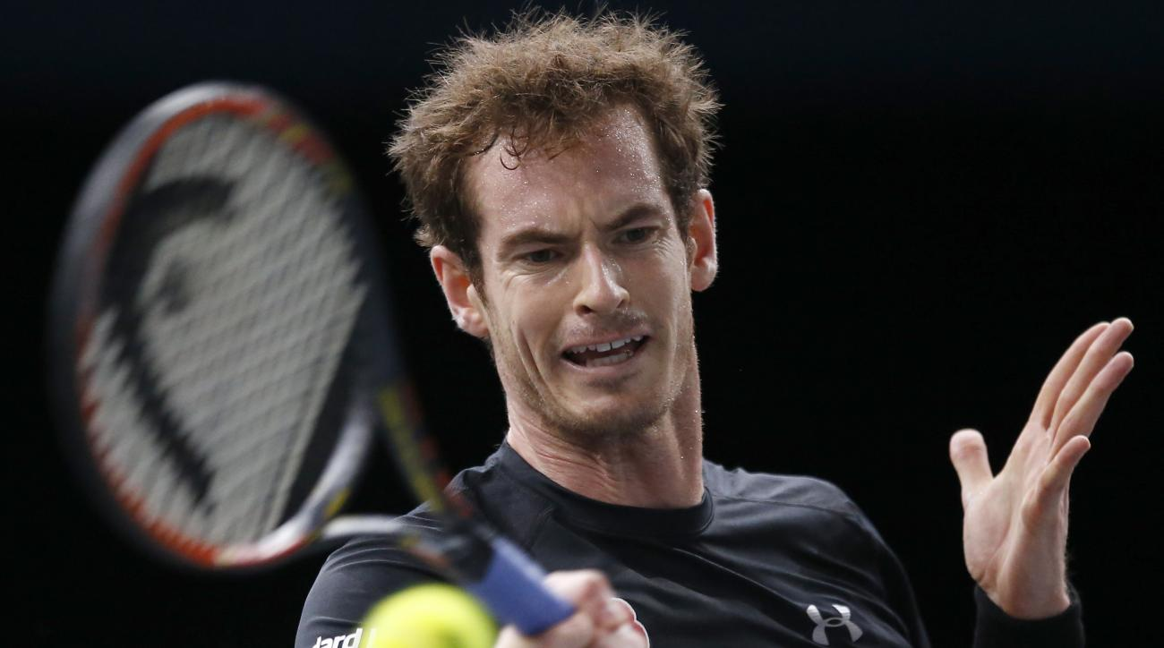 Britain's Andy Murray returns the ball to David Goffin of Belgium, during their round of sixteen match of the BNP Masters tennis tournament, at the Paris refurbished Bercy Arena, in Paris, France, Thursday, Nov. 5, 2015. (AP Photo/Francois Mori)