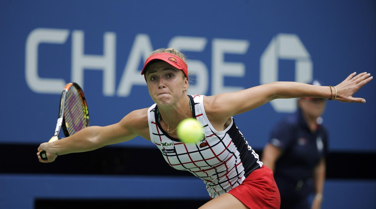 Elina Svitolina, of Ukraine, reaches to return a shot to Ekaterina Makarova, of Russia, during the third round of the U.S. Open tennis tournament, Friday, Sept. 4, 2015, in New York. (AP Photo/Matt Rourke)