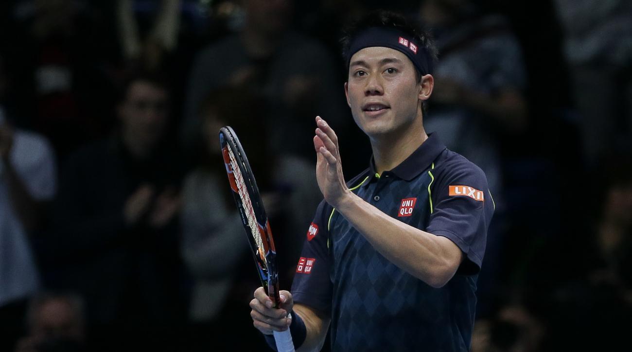 Japan's Kei Nishikori celebrates defeating the Czech Republic's Tomas Berdych during their ATP World Tour Finals tennis match at the O2 Arena in London, England, Tuesday Nov. 17, 2015. (AP Photo/Tim Ireland)