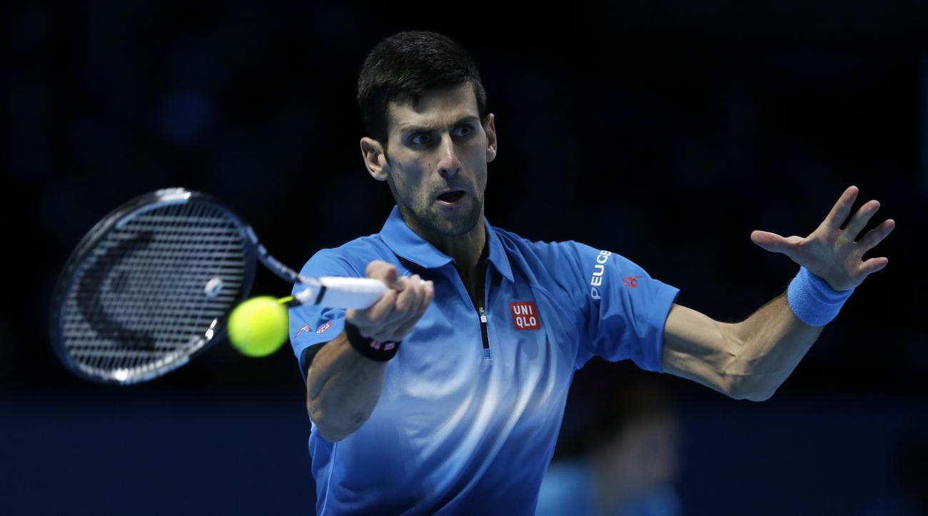 Serbia's Novak Djokovic plays a return to Spain's Rafael Nadal during their ATP World Tour Finals tennis match at the O2 Arena in London, England, Saturday Nov. 21, 2015. (AP Photo/Tim Ireland)