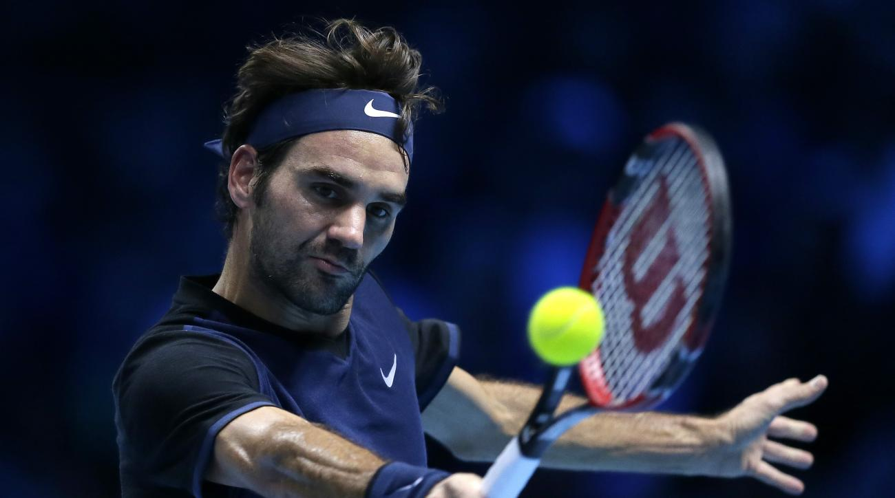 Roger Federer of Switzerland plays a return to Novak Djokovic of Serbia during their ATP World Tour Finals final tennis match at the O2 Arena in London, Sunday Nov. 22, 2015. (AP Photo/Tim Ireland)