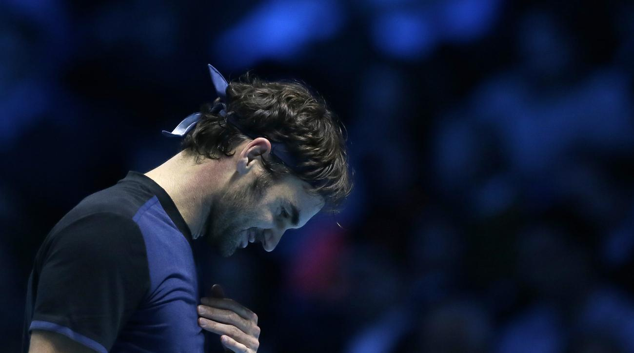 Roger Federer of Switzerland looks dejected after losing a point toNovak Djokovic of Serbia during their ATP World Tour Finals final tennis match at the O2 Arena in London, Sunday Nov. 22, 2015. (AP Photo/Tim Ireland)
