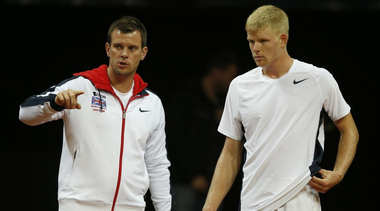Britain's Kyle Edmund, right, talks to team captain Leon Smith  as he takes part during a practice session for the Davis Cup Final between Belgium and Britain, in Ghent, Belgium, Wednesday, Nov. 25, 2015. The final starts Friday and runs until Sunday. (AP
