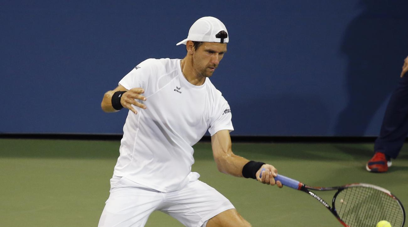 Jurgen Melzer, of Austria, hits a forehand to Tomas Berdych, of the Czech Republic, at the U.S. Open Tennis tournament in New York, Thursday, Sept. 3, 2015. (AP Photo/Kathy Willens)