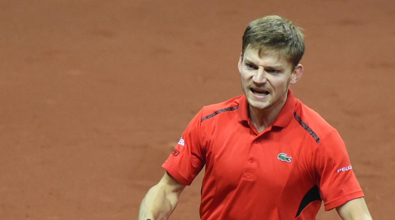 Belgium's David Goffin celebrates after defeating Britain's Kyle Edmund in their Davis Cup final tennis match at the Flanders Expo in Ghent, Belgium, Friday, Nov. 27, 2015. Goffin won the match and gave Belgium a 1-0 lead. (AP Photo/Geert Vanden Wijngaert