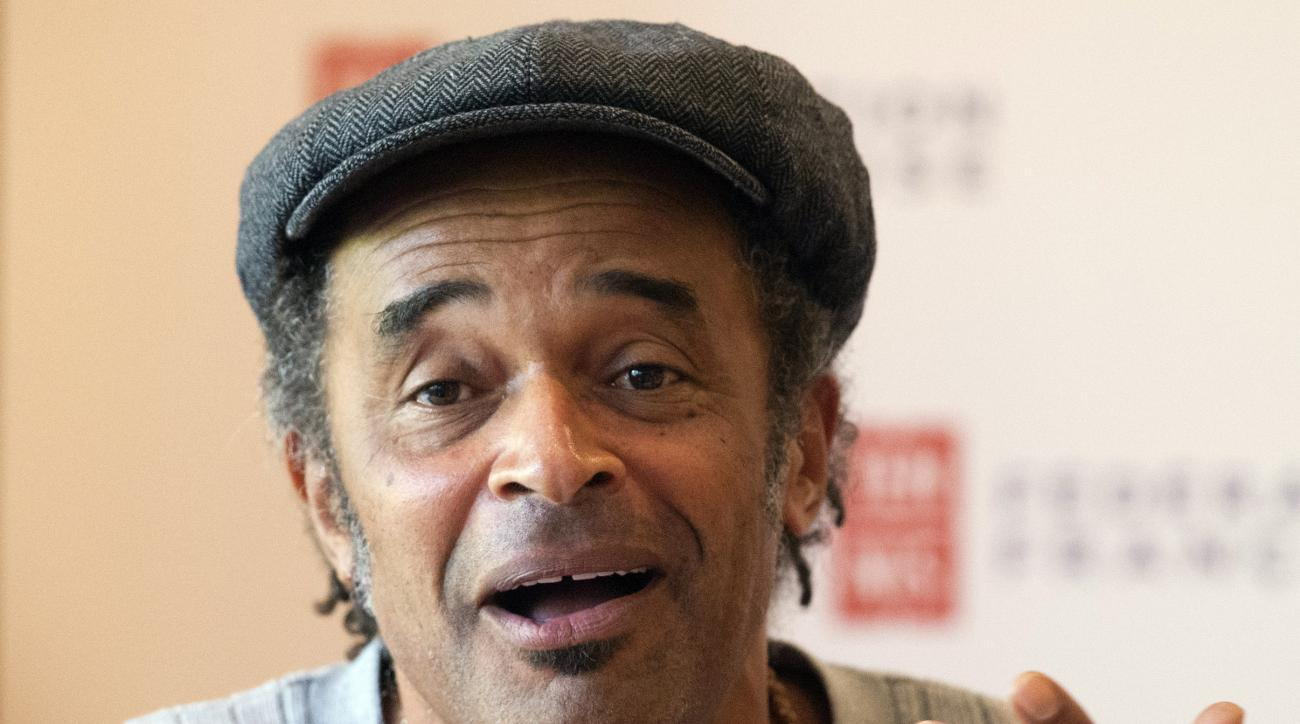 Yannick Noah, the last Frenchman to win a Grand Slam tournament, answers reporters during a  press conference at the Roland Garros stadium in Paris, France, Tuesday, Sept. 22, 2015. Noah has been appointed as the new France Davis Cup captain Monday. (AP P