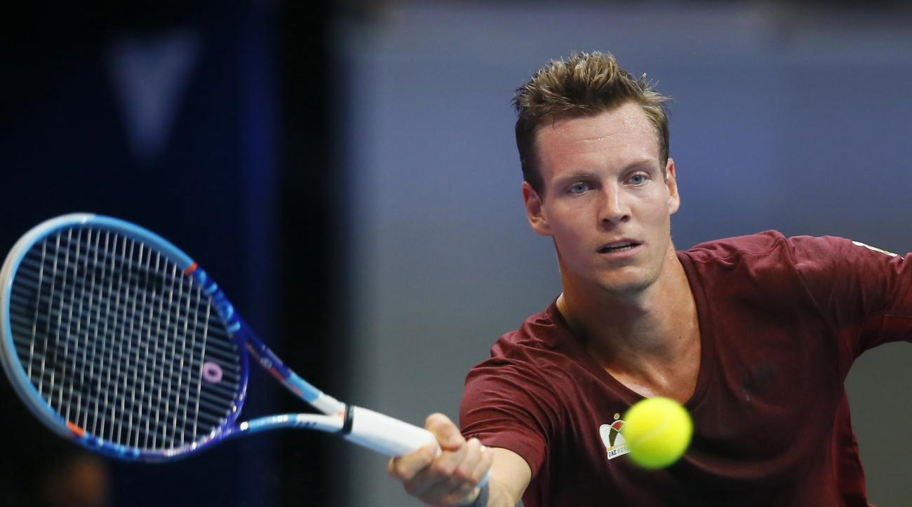 Czech Republic's Tomas Berdych of the UAE Royals returns a shot to Australia's Nick Kyrgios of the Singapore Slammers during their men's singles match in the International Premier Tennis League Tuesday, Dec. 8, 2015 at the Mall of Asia Arena in suburban P