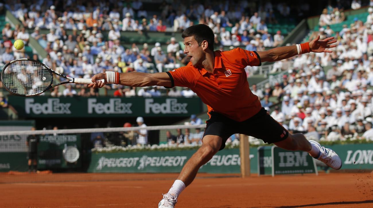 FILE - In this June 5, 2015 file photo Serbia's Novak Djokovic stretches to return the ball to Britain's Andy Murray, right, during their semifinal match of the French Open tennis tournament at the Roland Garros stadium in Paris, France. (AP Photo/Francoi