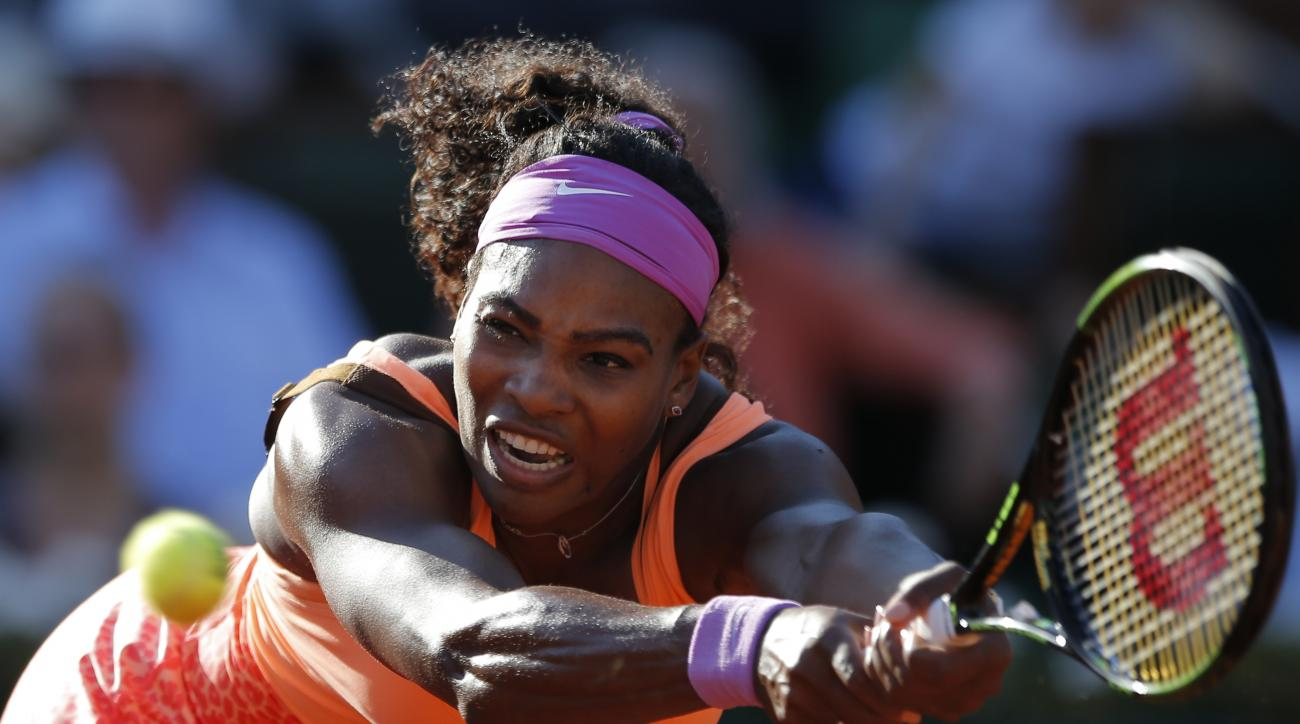 FILE - In this June 4, 2015, file photo, Serena Williams, of the United States, returns a shot in her semifinal match of the French Open tennis tournament against Timea Bacsinszky, of Switzerland, at the Roland Garros stadium in Paris. For the fourth time