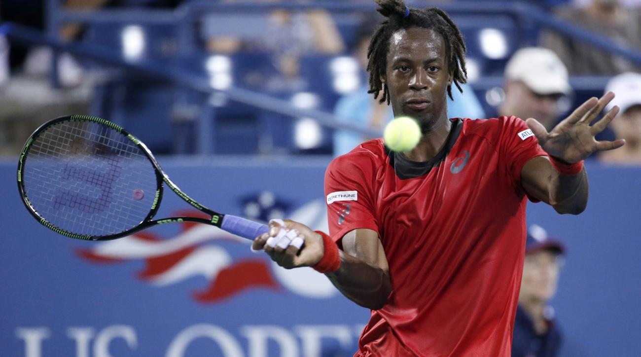 Gael Monfils, of France, returns a shot to Illya Marchenko, of the Ukraine, during the first round of the U.S. Open Tennis tournament in New York, Monday, Aug. 31, 2015.  (AP Photo/Julio Cortez)