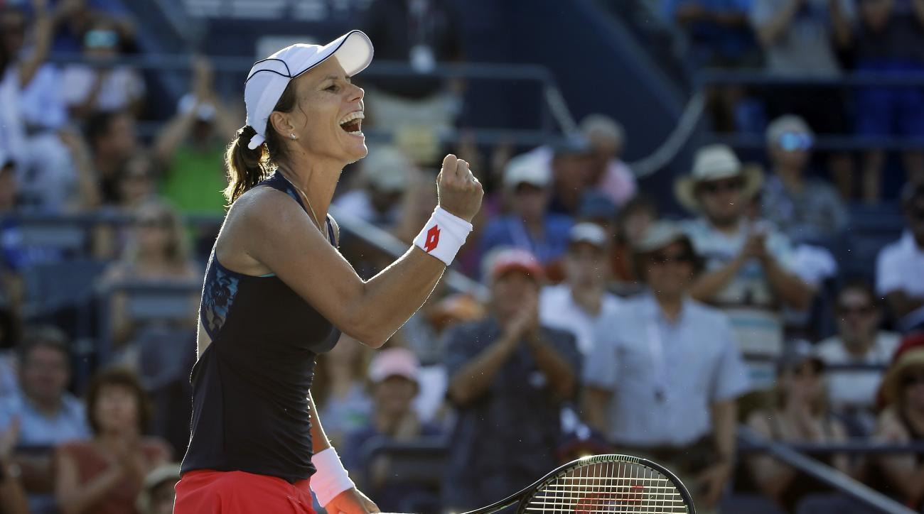 Varvara Lepchenko, of the United States, reacts after defeating Mona Barthel, of Germany, during the third round of the U.S. Open tennis tournament, Saturday, Sept. 5, 2015, in New York. (AP Photo/Matt Rourke)