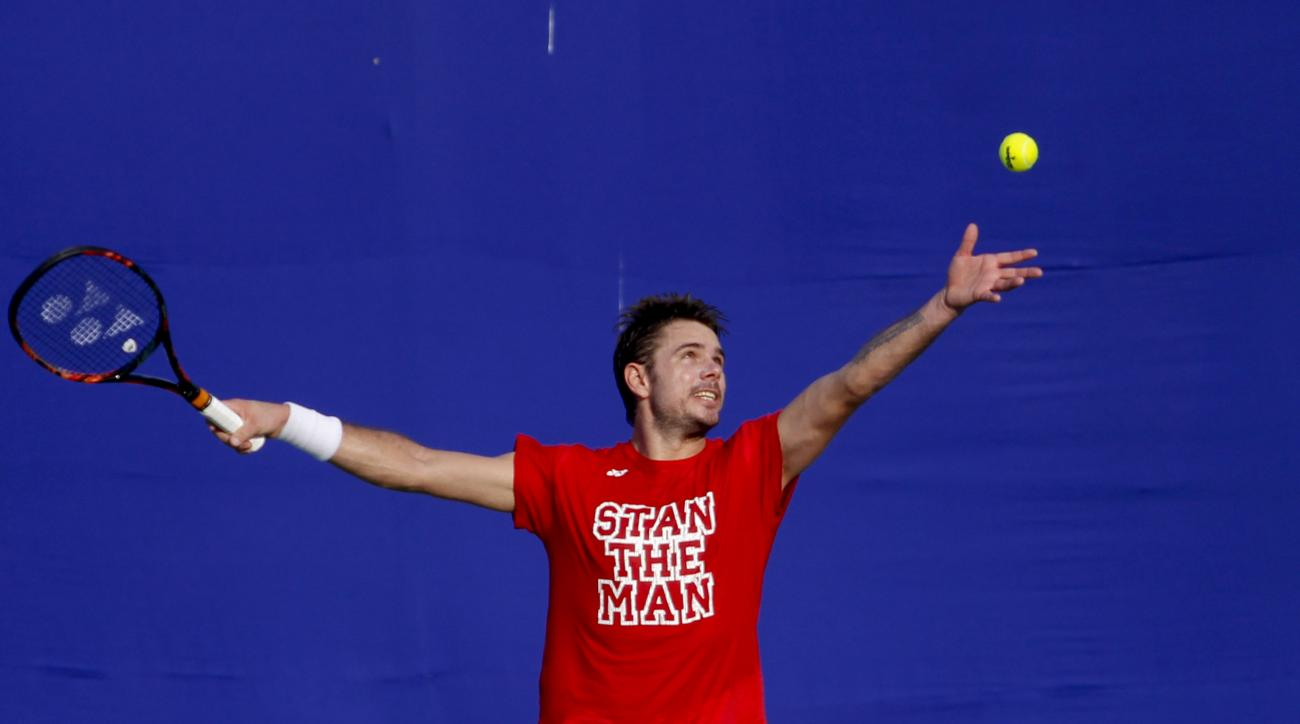 Switzerland's Stan Wawrinka prepares to serve during a practice session at the ATP Chennai Open tennis event in Chennai, India, Monday, Jan.4, 2016. (AP Photo/Arun Sankar K)