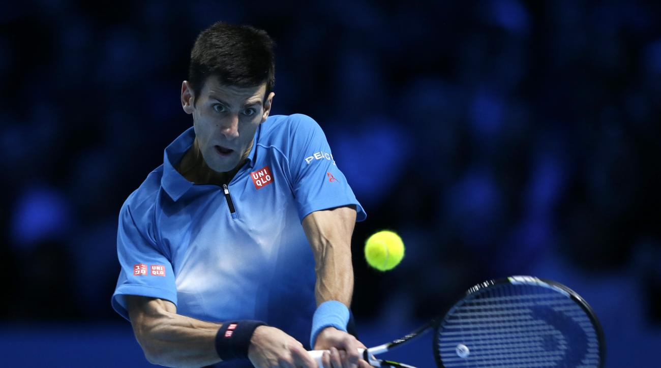 Novak Djokovic of Serbia plays a return to Roger Federer of Switzerland during their ATP World Tour Finals final tennis match at the O2 Arena in London, Sunday Nov. 22, 2015. (AP Photo/Tim Ireland)