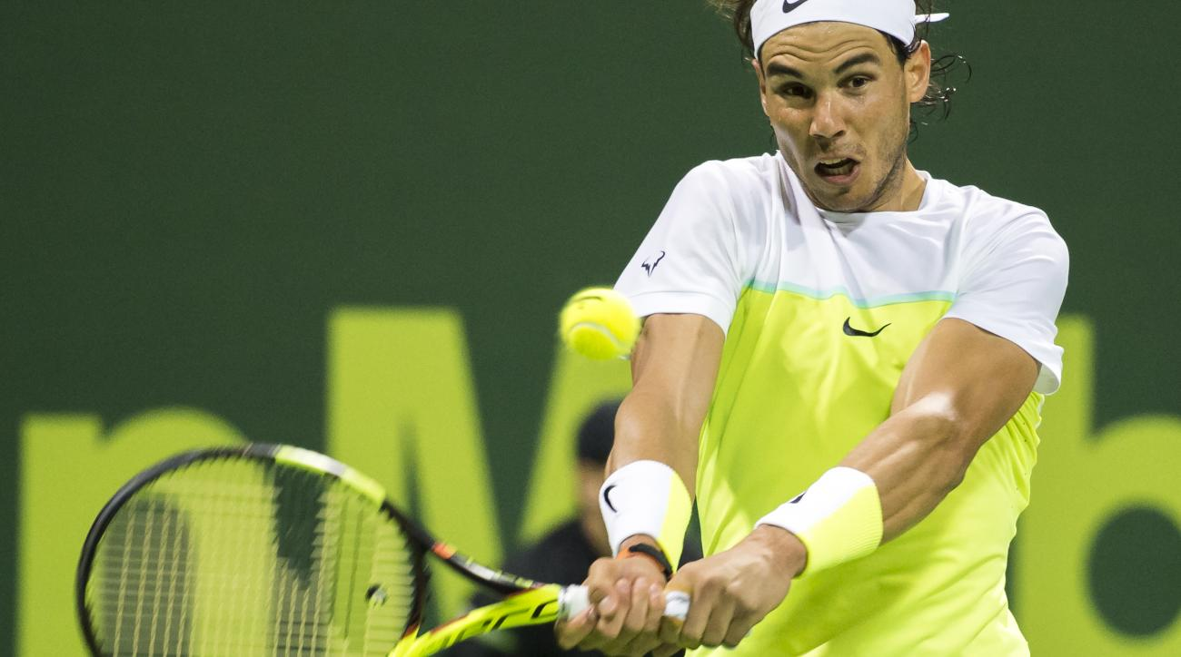 Spain's Rafael Nadal returns the ball during a match against Andrey Kuznetsov of Russia at Qatar Open tennis tournament Thursday, Jan. 7, 2016, in Doha, Qatar. (AP Photo/Alexandra Panagiotidou)