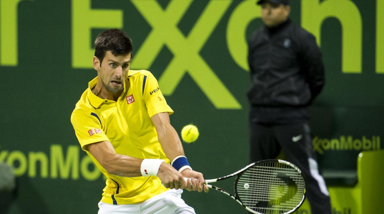 Serbia's Novak Djokovic returns the ball during a match against Leonardo Mayer of Argentina at Qatar Open Tennis tournament Thursday, Jan. 7, 2016, in Doha, Qatar. (AP Photo/Alexandra Panagiotidou)