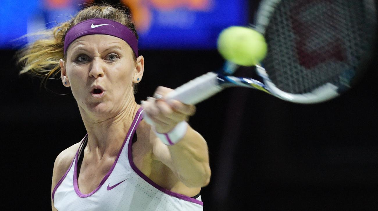 Lucie Safarova of the Czech Republic makes a forehand return against Angelique Kerber of Germany  during their singles match at the WTA tennis finals in Singapore on Friday, Oct. 30, 2015.  (AP Photo/Joseph Nair)