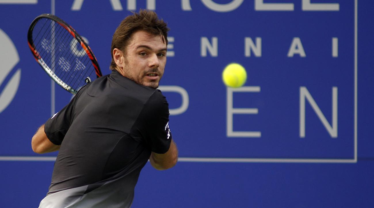 Switzerland's Stan Wawrinka plays a shot against Spain's Guillermo Garcia Lopez at Chennai Open tennis tournament in Chennai, India, Jan. 8, 2016. Wawrinka beat Lopez in straight sets 6-4, 6-4. (AP Photo/Arun Sankar K)