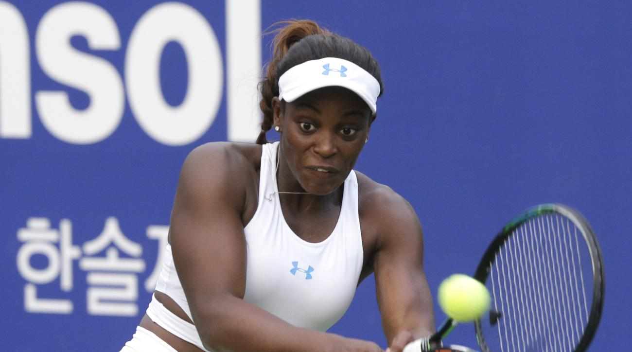 Sloane Stephens of the United States returns a shot against Aliaksandra Sasnovich of Belarus during the quarterfinal match of the Korea Open tennis championships in Seoul, South Korea, Friday, Sept. 25, 2015. (AP Photo/Ahn Young-joon)
