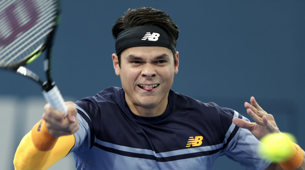 Milos Raonic of Canada plays a shot in his semifinal game against Bernard Tomic of Australia during the Brisbane International tennis tournament in Brisbane, Australia, Saturday, Jan. 9, 2016. (AP Photo/Tertius Pickard)